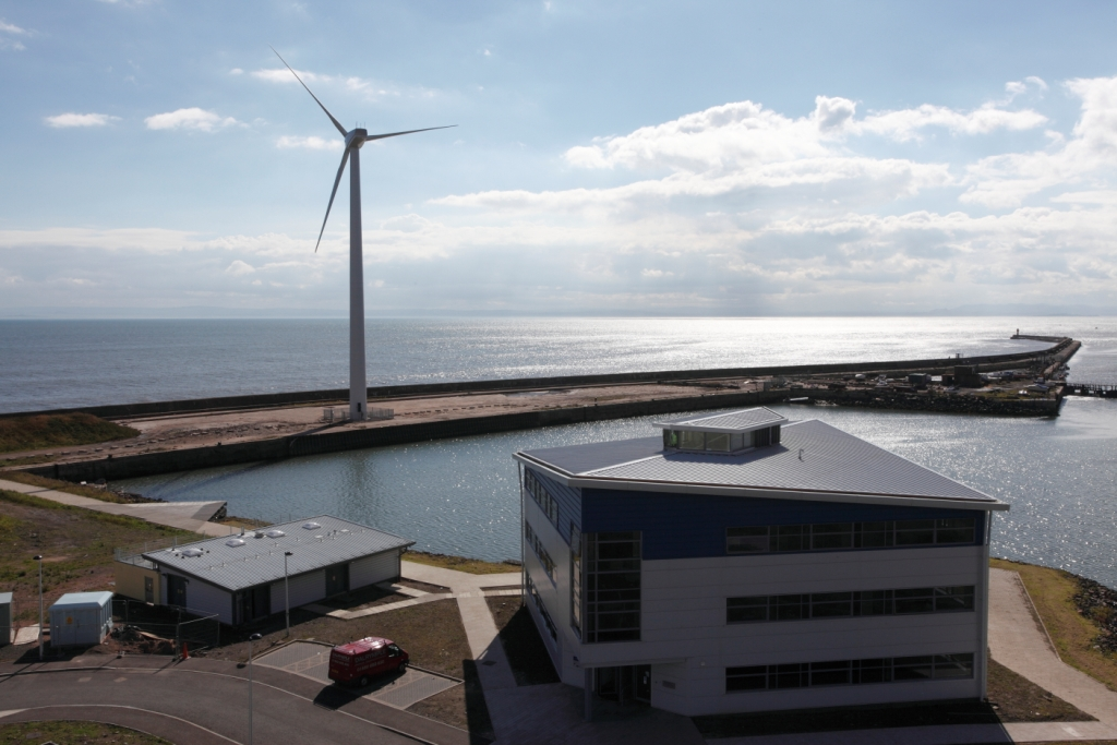 A picture of the office, energy centre and Poppy the Wind Turbine