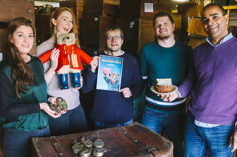 Scaramanga owner Carl Morenikeji (right) and staff members (from left) Lois, Kelly, Graham and Calum celebrate the Fife vintage specialist supplying antique padlocks to new family movie Paddington 2 with marmalade sandwiches and a vintage Paddington bear.