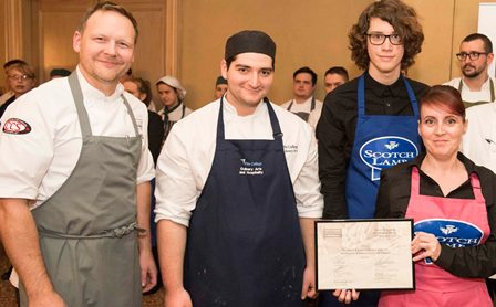 Students, Marios Kyriakou, Tracy Peake and Adam Richards receive their award from Geoffrey Smeddle of the Peat Inn.